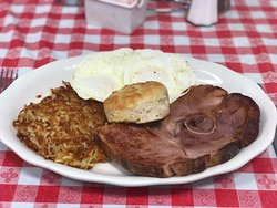 country ham with eggs hash browns and a biscuit