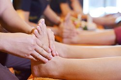 Massage through reflex points of body on the feet helps to keep balance of body system