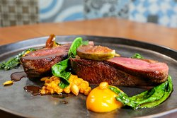 Seared Duck breast ,red lentil dhal ,wilted spinach,butternut squash Puree, fig  jam