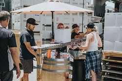 Teamwork gets the job done and it takes a village to make it through bottling day.
