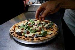Pizza cesar. Cesar's pizza.