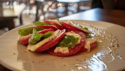 Tasty and fresh.  Tomatoes with mozzarella, basil, olive oil and oregano.