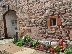 Well tended flower beds all around the courtyard
