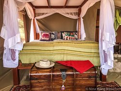 Four post Kingsize bed available in the luxury section of the camp