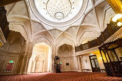 inside view of the masjid with live recitor on the far right