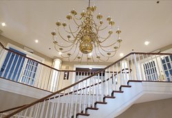 The elegant chandelier and staircase.