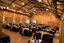 Cluster Style Seating with Round Tables & Chairs Capacity - 150 Guests.