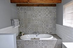 Milkwood Trail Cottage (sleeps 4 adults, 2 kids). Master bathroom with tub & outdoor shower.