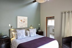 Milkwood Trail Cottage (sleeps 4 adults, 2 kids). Master bedroom & bathroom. King or 2 singles.