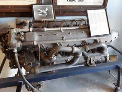 A water cooled airplane engine and a photo of the plane that used it.