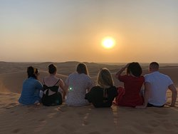 Group photo during sunset in the desert