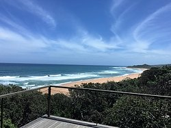 View from the Zinkwazi Beach House.  This luxury three floor holiday home is situated on the beach front in the in the indigenous coastal milkwood forest.  Glass sliding doors open to the ocean and forest