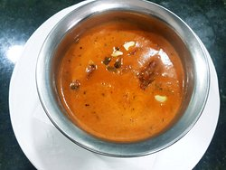 LAMB TIKKA MOSALLA Lightly spiced yougurt & cream cooked with mix nuts, sugar & coconat to creat an aromatic creamy dish.