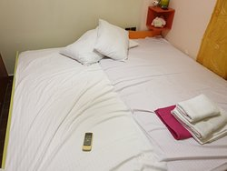This is how the room was presented when arrived. Do note the yellow stains on the sheets.