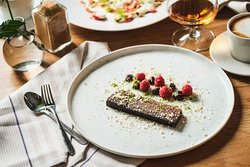 Typical dessert at Nalen Restaurang – chocolate cake with Swedish berries and curd