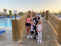The family posing on the bridge at the main pool in the evening.