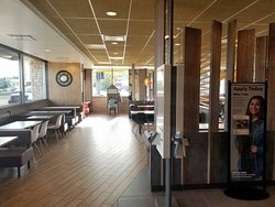 dining area for McDonald's and an order kiosk