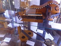The stringed instrument display with a Hurdy Gurdy