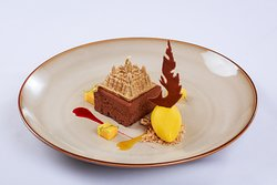 Flourless Chocolate Cake  With mango sorbet and raspberry coulis