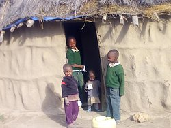 Maasai children at home after coming back from school