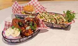 chicken wings with Mofo sauce, loaded fries and lamb slider from the AFL event menu
