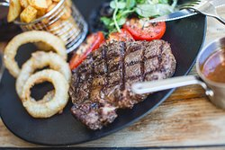 Rump 10oz Served with a Field Mushroom, Plum Tomato & Onion Rings, with Either Chips or Fries.