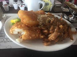 Two piece fish and chips with dressing and gravy on the side