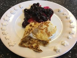 Lemon ricotta crepe with a blueberry sauce and homemade whipped cream