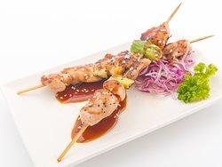 Yakitori Chicken Skewer - Izakaya Style marinated chicken fillet on skewer, fire of old fashion charcoal