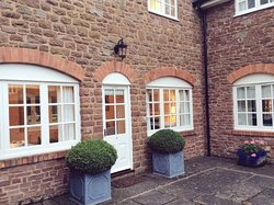 Elgar Cottage with arched windows and plenty of light