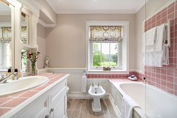 Elgar cottage bathroom with power shower over bath