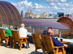 Relax on the outside terrace looking across the Mersey to the Liverpool skyline