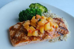Salmon with fruit sauce on top
