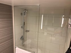 nice, big and clean shower.  Includes a shower wand.