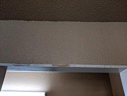 Dirty walls and door frame into bathroom