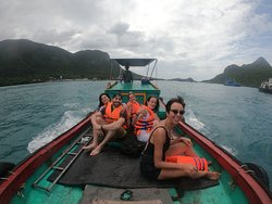 near island snorkeling tour with wooden boat