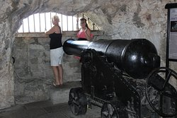 One of the siege guns inside the tunnels, the view of the coast is superb