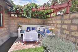Relaxing area under the pergola - lavender Suite.