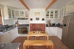 Dinning area in the big fully equipped kitchen shared by Jasmine and Fuchsia guests. Great for self catering.
