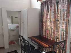 Boer & Brit Self Catering triple room private bathroom and seating area