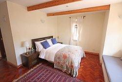 Very cozy and comfortable bedroom of Gardenia Suite.