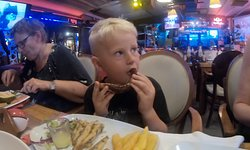 This is small fried fish - and my son with a piece of my grilled octopus. Deliscous.
