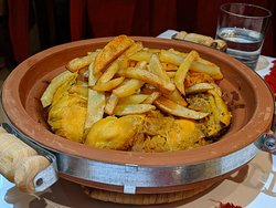 Chicken and onion tagine with potato chips on top