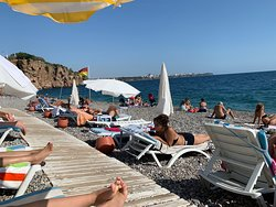 Fantastic beach with pebbles and good food & drinks available on the beach, all payable with credit card no need for cash. You can rent sunbead and parasol for cheap. The sea is warm and clean (in October ). Not crowded and the temp is mild 25-30degC.