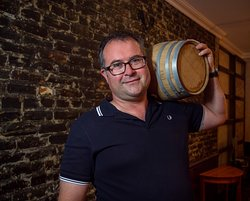Keith with a smaller barrel of whiskey