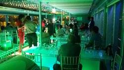 All the guests are enjoying Live Singer with Dance Floor in Catamaran Cruise.
