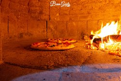 our wood-fire oven where we prepare your pizzas