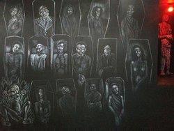 Mural of coffins in basement