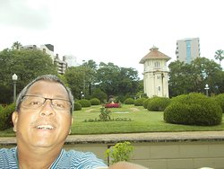 With some globe-shaped shrubs of the garden behind me (right in front of the Building before entering the garden)
