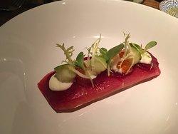 Starter of sashimi grade tuna but smoked and served with green apple